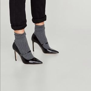 Fashion black shoes with sock inserted